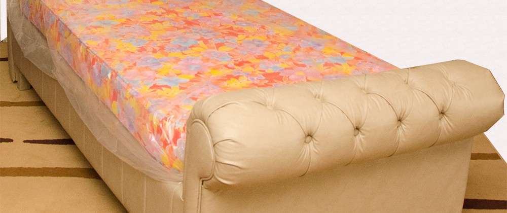 Upholstered bed with arms